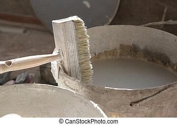 Brush in the bucket