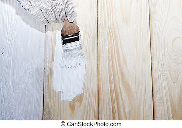 brush on a wooden background.