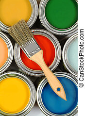 Brush on paint cans - A wooden brush on paint cans of ...