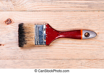 Brush on wooden background.
