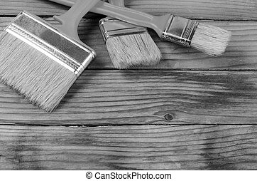 Brush painting paint on wooden background