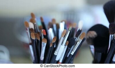 Brush set for make-up on the table, Makeup brush on wooden table, Shallow depth of field