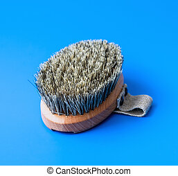 Brush with bristles made of horsehair on a blue background