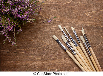 brushers on brown wooden background