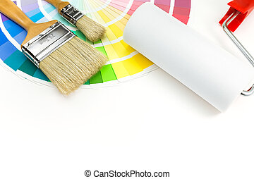 Brushes and paint roller over color samles catalog