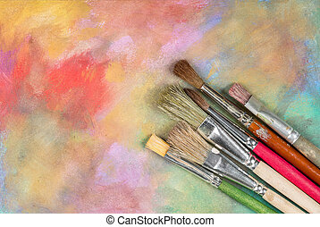 Brushes - Different brushes on a colorful canvas.