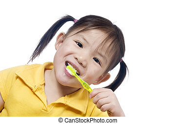 Brushing Teeth - A young girl brushing herteeth. Health and...