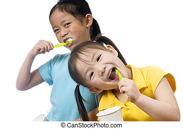 Brushing Teeth - Two sisters brushing thier teeth. Health...