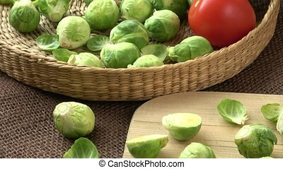 Brussels sprouts (Brassica oleracea) tomato, leek in a...