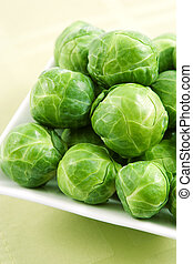 Fresh brussels sprouts on a white plate