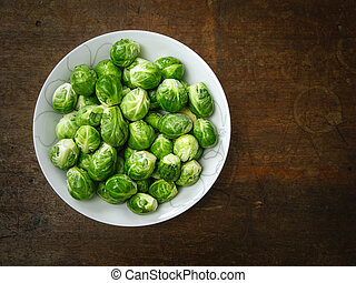 Brussels sprouts on old wood table
