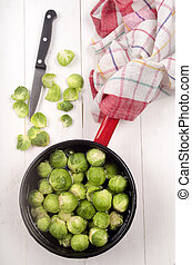 brussels sprouts with water in a pot