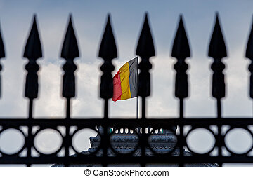 National Belgian flag on the background of the peak. Brussels. Belgium.