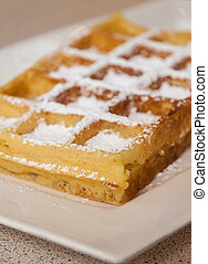 Brussels waffle with chocolate and powdered sugar