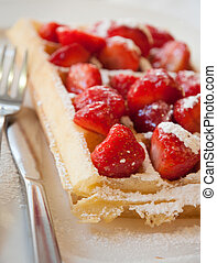 Brussels waffle with strawberries and powdered sugar