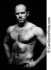 Brutal macho - Vertical portrait of shirtless man posing for...