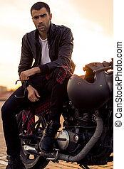 Brutal man sit on cafe racer custom motorbike. - Handsome...