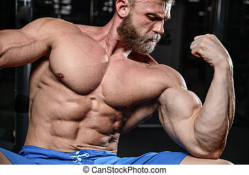 brutal muscular man with beard unshaven fitness model ...