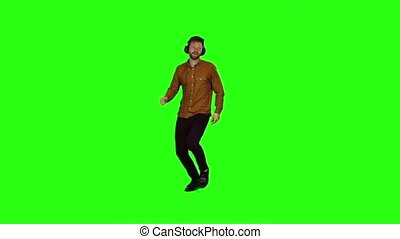 Bsinessman with headphones on his head, dancing energetic dances. Green screen. Slow motion