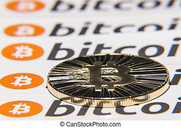 Shining metal BTC bitcoin coin on background from repeating bitcoin writings.