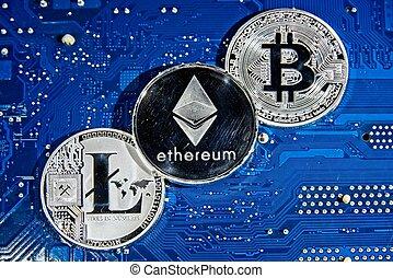 BTC LTC ETH Bitcoin Litecoin Ethereum coins on circuit board...