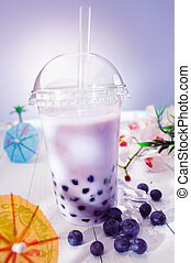 Bubble tea blended with milk and black currant berries and purple boba or pearls