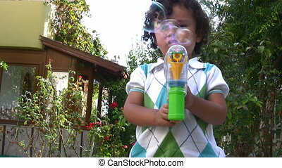 Bubble Toy  Full HD 1080P - Little boy playing in the Garden