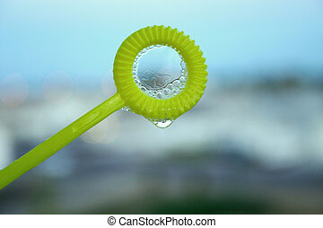 Bubble wand with bubbles
