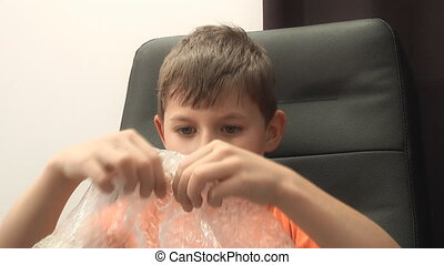 Bubble Wrap, - Bubble Wrap in the hands of a child