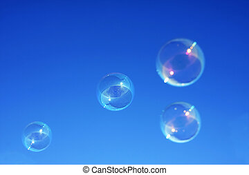 Bubbles against a blue sky