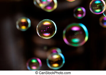 Close up photo of colorful bubbles in the room