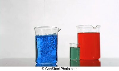 Bubbles in a super slow motion moving in a blue beaker...