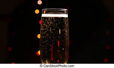 Bubbles inside a glass of champagne against the background...