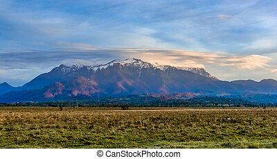 Bucegi mountains, Brasov, Romania: Landscape view in the sunset light of the snowy, Bucegi, Romania