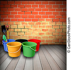 Bucket and shovel with a brick wall.