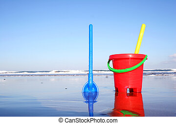 Bucket and Spade - Children's bucket and spade on the beach