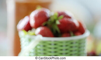 Bucket full of strawberry out and in focus
