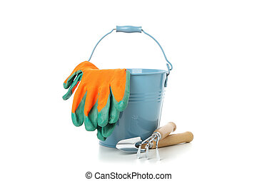 Bucket, gloves and gardening tools isolated on white background