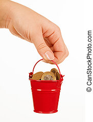 Bucket of money in hand on a white