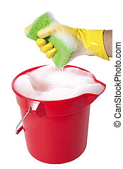 Bucket of Soap - A sudsy bucket or pale of soap with a hand...