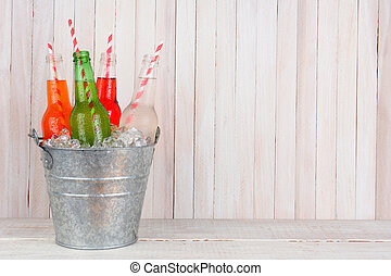 Bucket of Soda with Copy Space - An ice bucket of four...