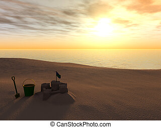 A bucket, spade and sand castle on a beach at sunset.