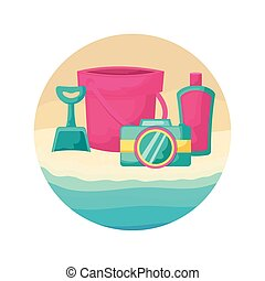 bucket with camera and bottle of blocker in beach