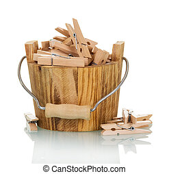 Bucket with wooden clothespins close-up isolated on white.