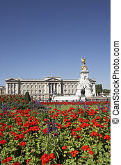 Buckingham Palace With Flowers Blooming In The Queen's...