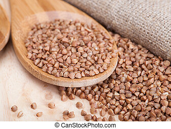 buckwheat - Buckwheat in wooden spoon on wooden table