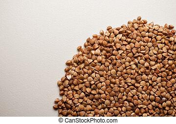 Buckwheat grains pile isolated on white background