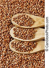 buckwheat groats and wooden spoon