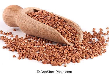 Buckwheat in a wooden scoop isolated on white background