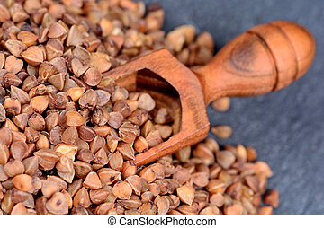 Buckwheat in a wooden scoop